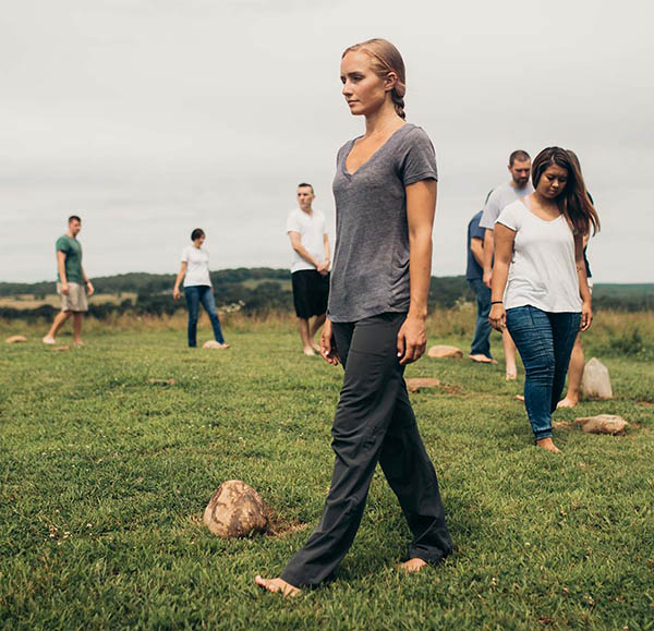 patients walking barefoot in circle outside