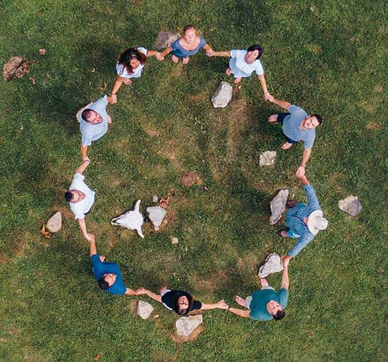 birds eye view of circle of patients holding hands